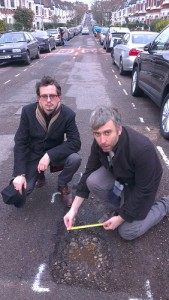 Cllr Richard Wilson and a local resident, Ben Myring inspecting a pothole on Inderwick Road